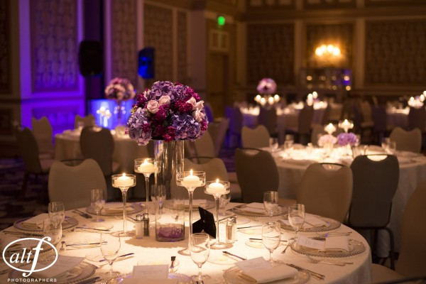 Glass bases made it seems as if our purple centerpieces were floating over the tables.