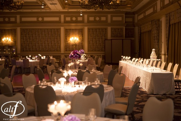 I love the look of one long head table at the front of a wedding reception.