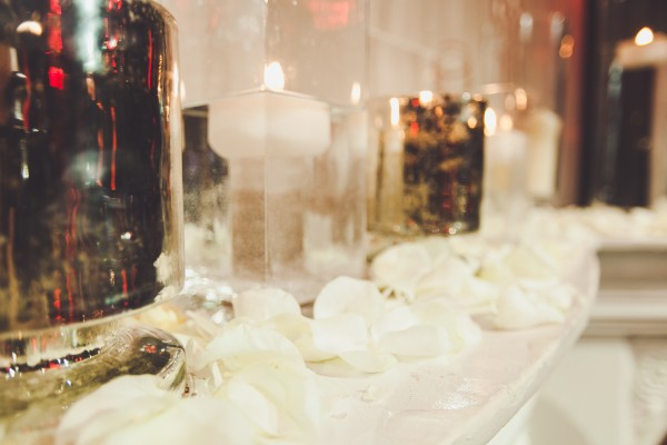 Candle and rose petals were set upon the mantle of the fireplace. Photo by Adam Trujillo.