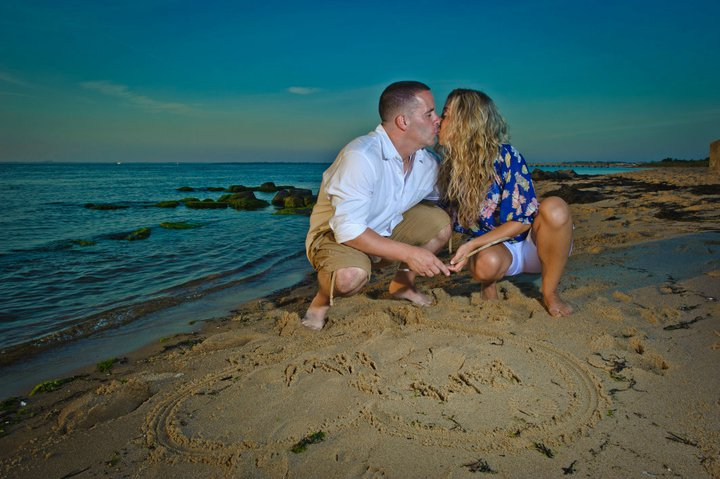 Drawing in the sand.  Engagement Photos by Lighthouse Photography.
