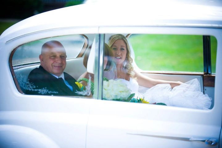 There is nothing like the photo of a bride arriving in a Rolls Royce with her parents.  Photo by Lighthouse Photography.