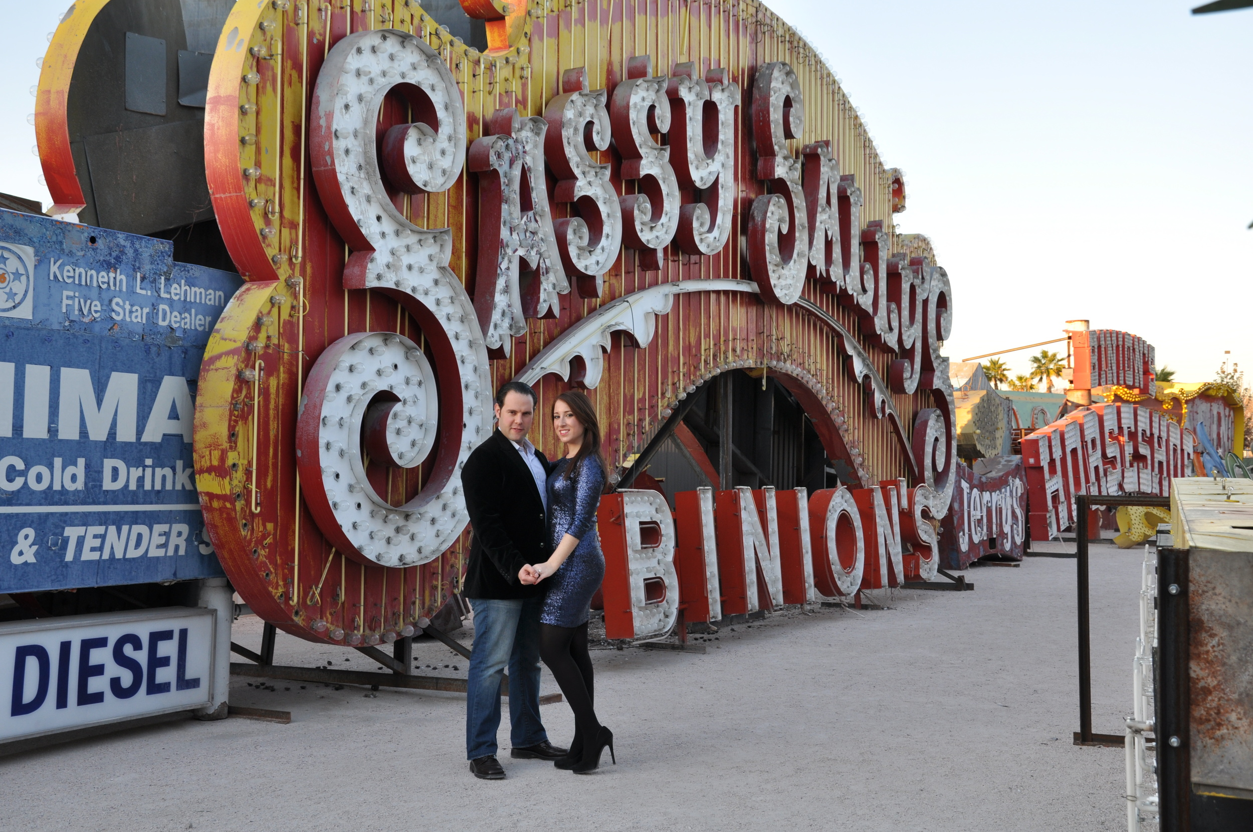Engagement Photos at Neon Graveyard - Super colorful and perfect for a Las Vegas Destination Wedding!