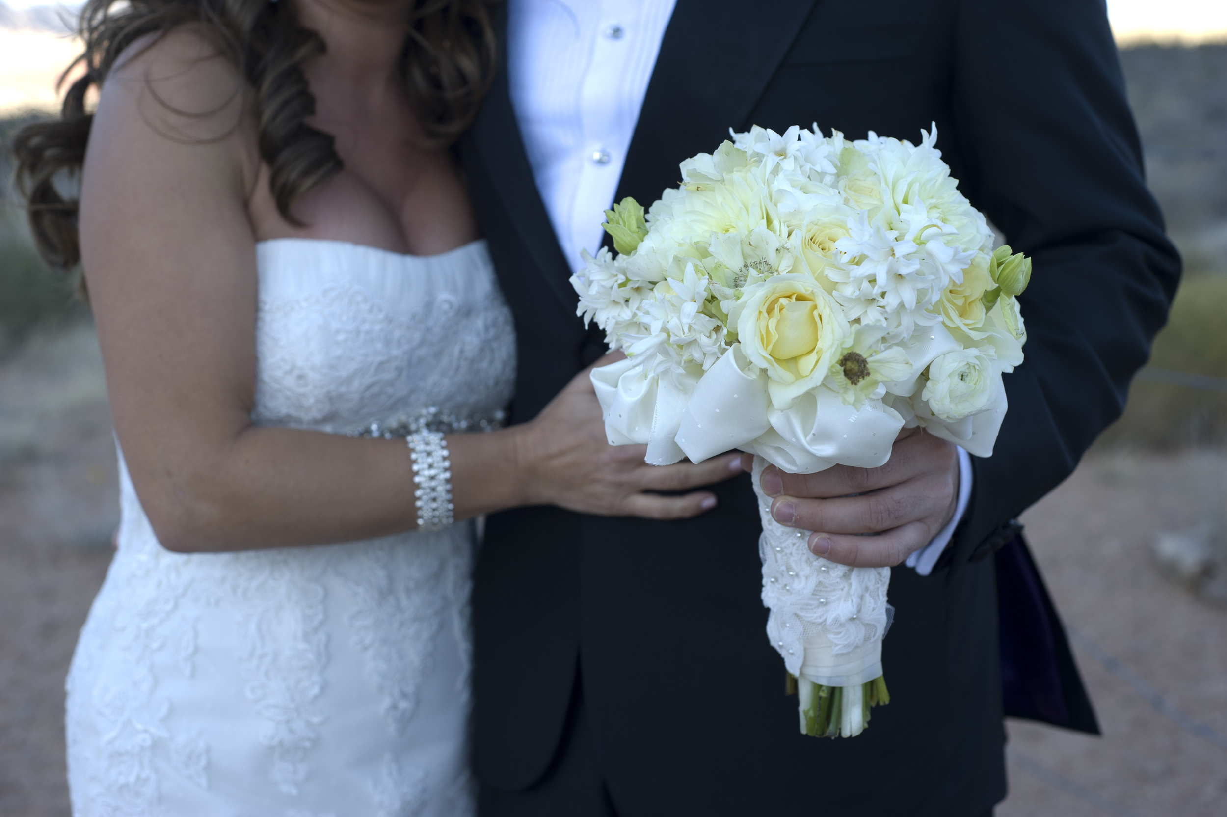 Gorgeous shot of her bouquet! The stems were wrapped in extra fabric from her dress!