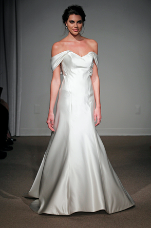 While I am hopelessly enamored with the first dress, I have to say that Ulla-Maija surpasses it in the way of gorgeously draping both arms! So sensual! And off all the fabrics I have seen, this is just beyond! Photo by Dan Lecca. Courtesy of Wedding Wire.
