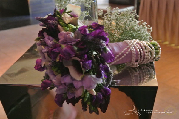 Fresh water pearls belonging to the bride's grandmother were wound around the handle of the bouquet. Flowers by Naakiti Floral.