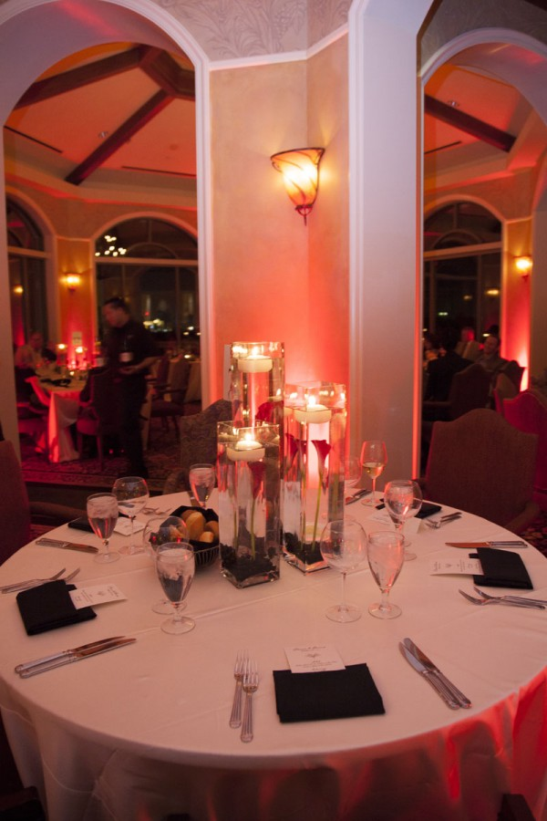 The Southern Highlands Golf Club was lit with red lighting and featured floating candle centerpiece. Photo by www.altf.com.