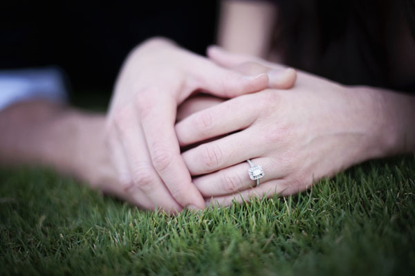 The perfect ring for her hand! Brian proposed with an emerald cut diamond surrounded bu round stones.