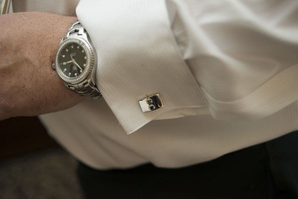 The watch was a gift from our first anniversary.  And the handmade cufflinks feature the birthdstones of our son and daughter.