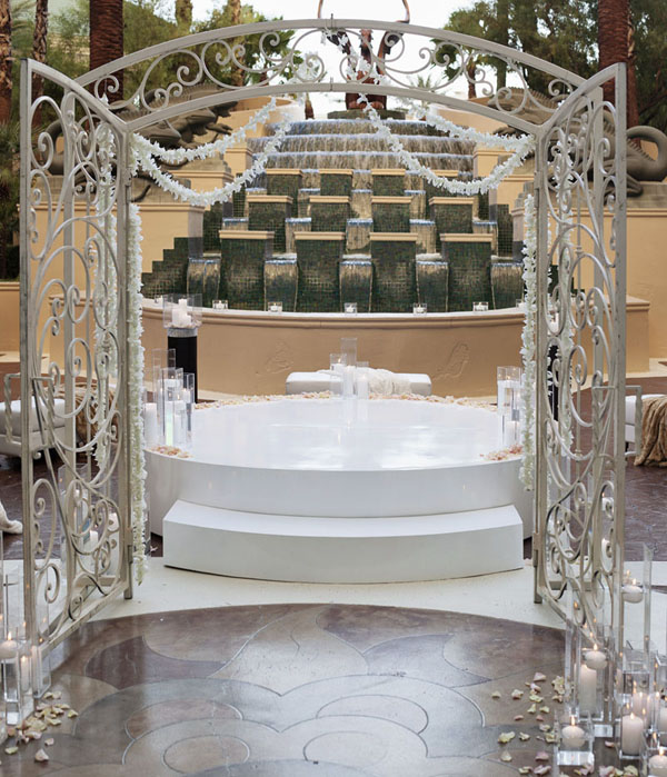 This vintage, Tuscan gate made for a dramatic entry point at the wedding ceremony.  Fountain Terrace, Four Seasons Las Vegas.  Photo by www.altf.com.