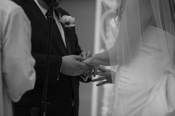 Exchanging wedding rings - A moment that was years in the making.  Photo by www.altf.com.