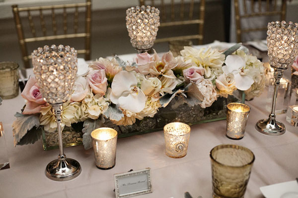 Blush and gold tones created a soft, romantic feeling.  Crystal candle holders added a touch of glamour to the timeless decor.  Photo by www.altf.com.