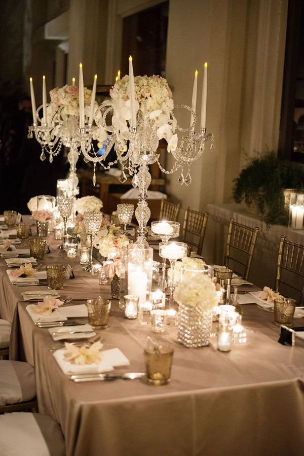 One long, family style banquet table was set with romantic crystal centerpieces, towering florals, crystal candle holders, and chiavari chairs.  Table Decor: Naakiti Floral.  Photo by www.altf.com.
