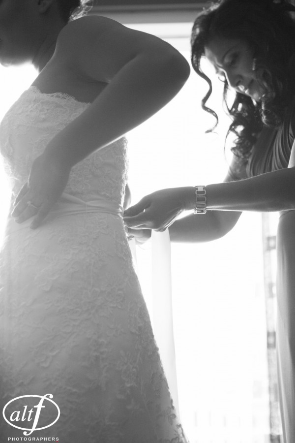 Kaitrin, the bride, accented her lace wedding dress with a white and crystl belt.