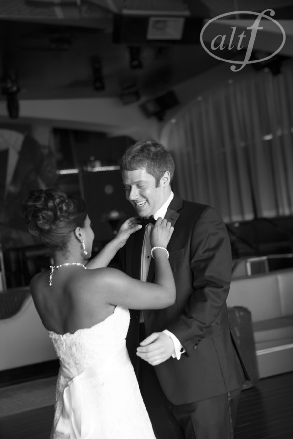 The bride greeted the groom on the dancefloor during their first look.