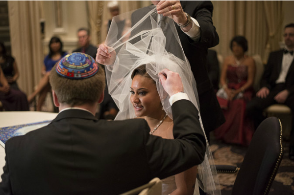 The Veiling Ceremony, otherwise known as the Bedekkon Ceremony, involved the groom placing the veil over the bride's face.