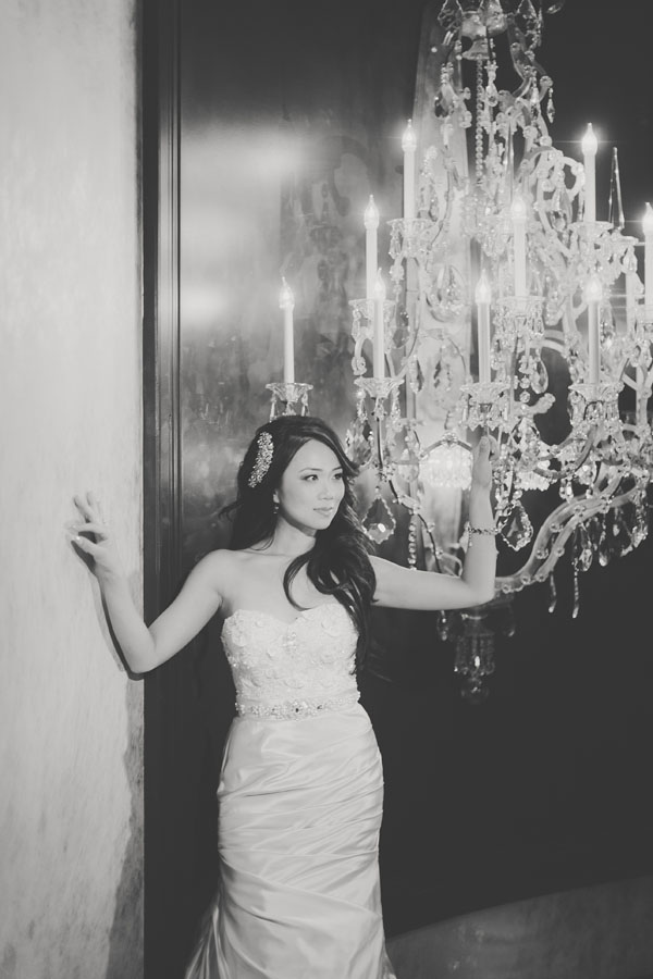 My bride My-Lee set against the dramatic chandeliers of Chateau Nightclub & Gardens. Photo by Adam Trujillo.