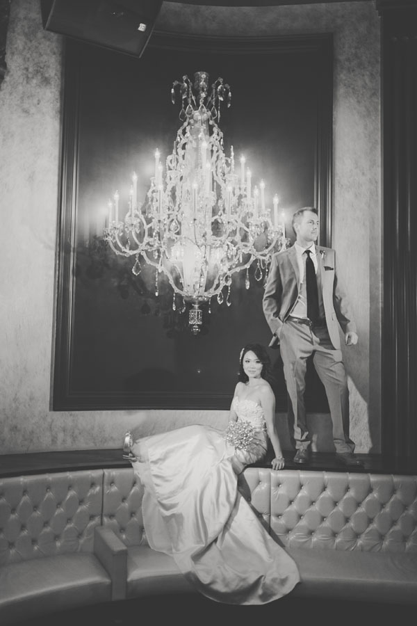 My-Lee & James' official wedding portrait. Chandeliers at Chateau Nightclub & Gardens. Photo by Adam Trujillo.