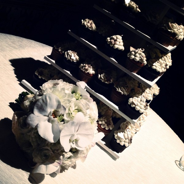 Marci's bouquet rested beside the cupcake tower – Just waiting to be devoured! Photo by Andrea Eppolito.