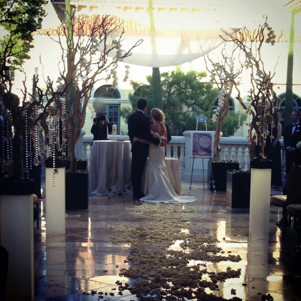 Marci & Mike wed on the gorgeous Grand Patio of Bellagio. Floral and decor by Naakiti Floral. Photo by Andrea Eppolito.
