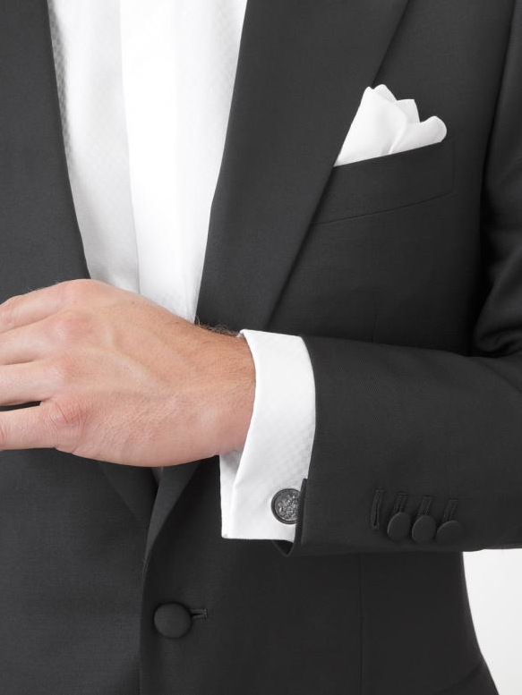 It's all in the details! Custom Clothier Astor & Black ensures that the groom is perfectly polished for his wedding day.