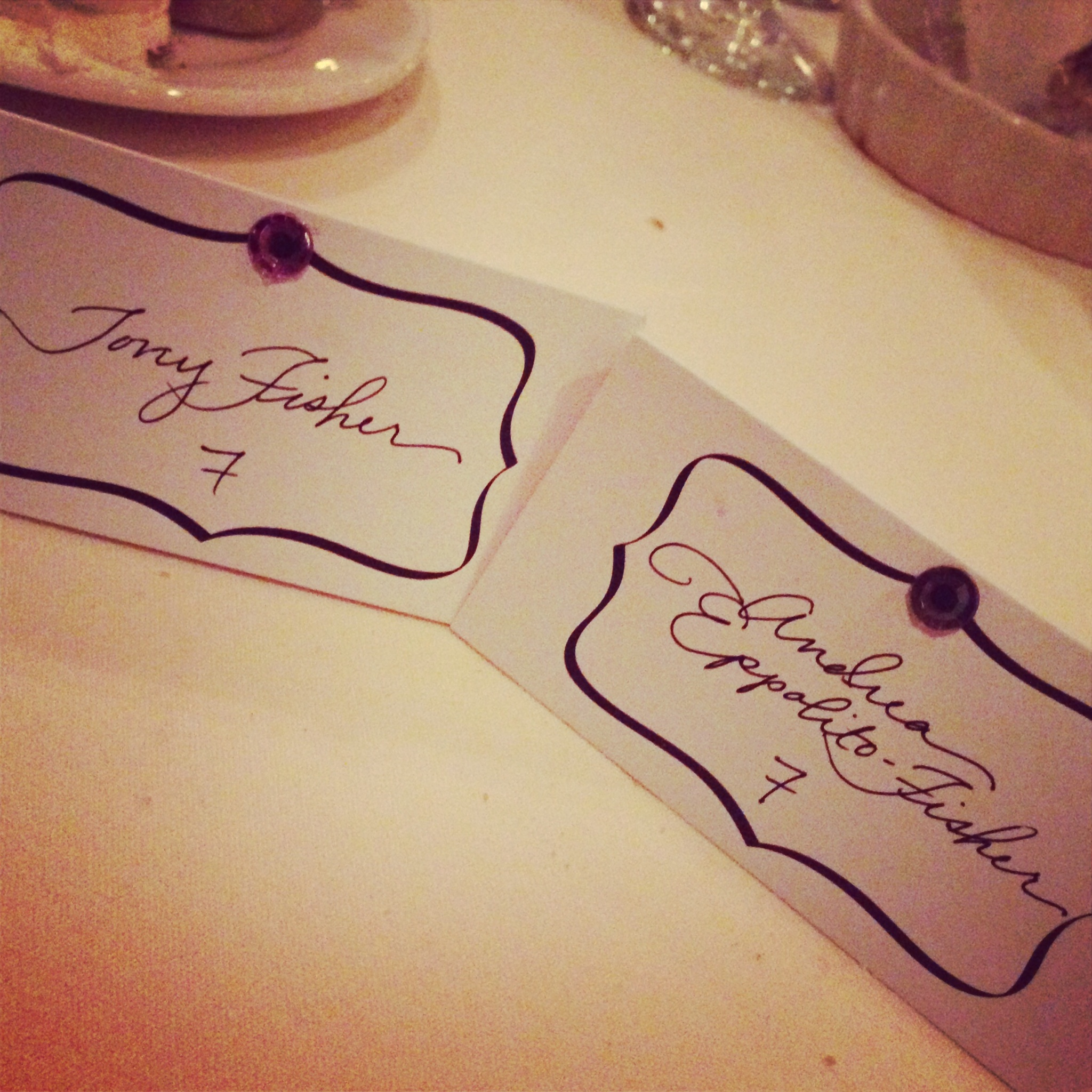 The bride wrote each and ever escort card by hand.