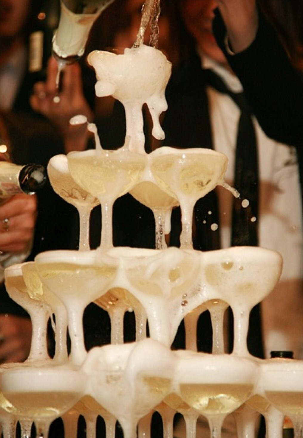 The classic champagne tower makes a stunning addition to any wedding and is one o those details that will get guests talking.