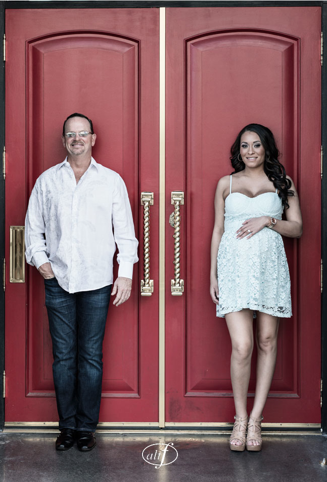 Megan and Alan took their engagement photos downtown in old Las Vegas.  The red wall made a perfect backdrop.