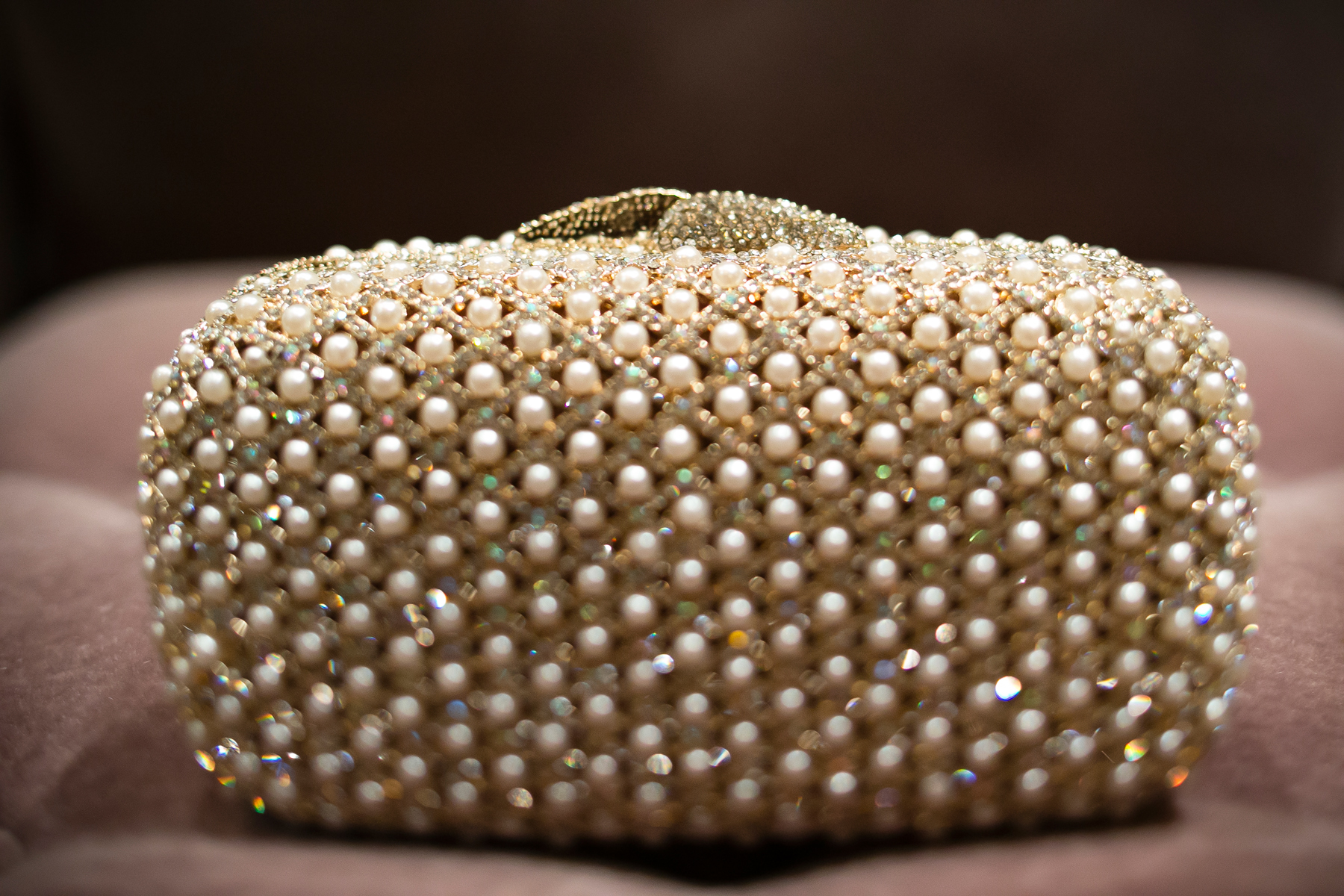 Who knew pearls and gold looked so good together?!?!  Bag Purchased at  Nordstrom .  Wedding Venue:  Bellagio Las Vegas.    Photo by  www.ronmiller.com .  Las Vegas Wedding Planner:  Andrea Eppolito Events
