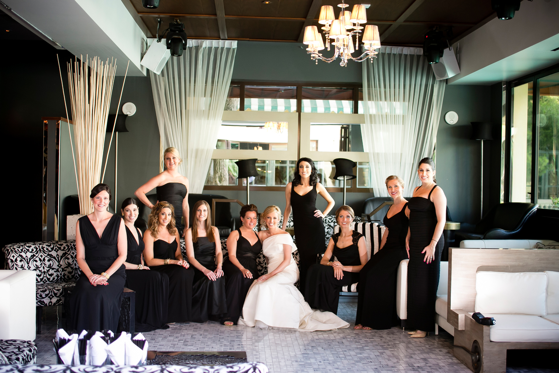 And the bridesmaids wore black.  Marci allowed each girl to select their own black dress, guaranteeing that they all looked stunning.  Wedding Venue:  Bellagio Las Vegas.   Location:  Hyde Bellagio .  Photo by  www.ronmiller.com .  Las Vegas Wedding Planner:  Andrea Eppolito Events .