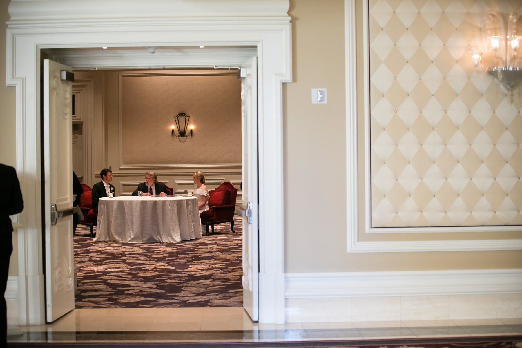 We watched from outside as Marci & Mike signed the Ketubah, which is the Jewish marriage agreement, surrounded by family and friends.  Wedding Venue: Bellagio Las Vegas.  Photo by www.ronmiller.com . Las Vegas Wedding Planner: Andrea Eppolito Events .