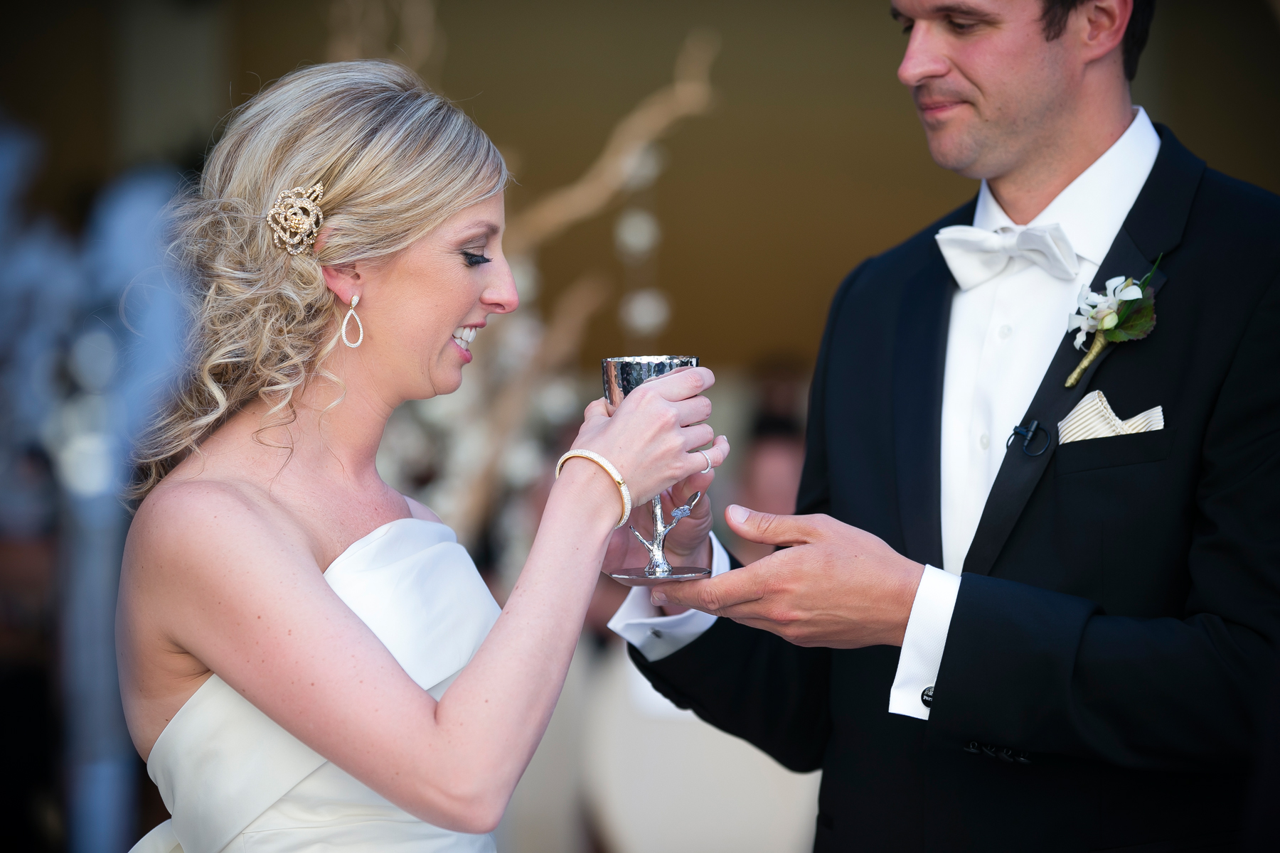 The bride & groom shared kosher wine from a kiddish cup.  Wedding Venue: Bellagio Las Vegas.  Location: The Grand Patio. Photo by www.ronmiller.com . Las Vegas Wedding Planner: Andrea Eppolito Events .