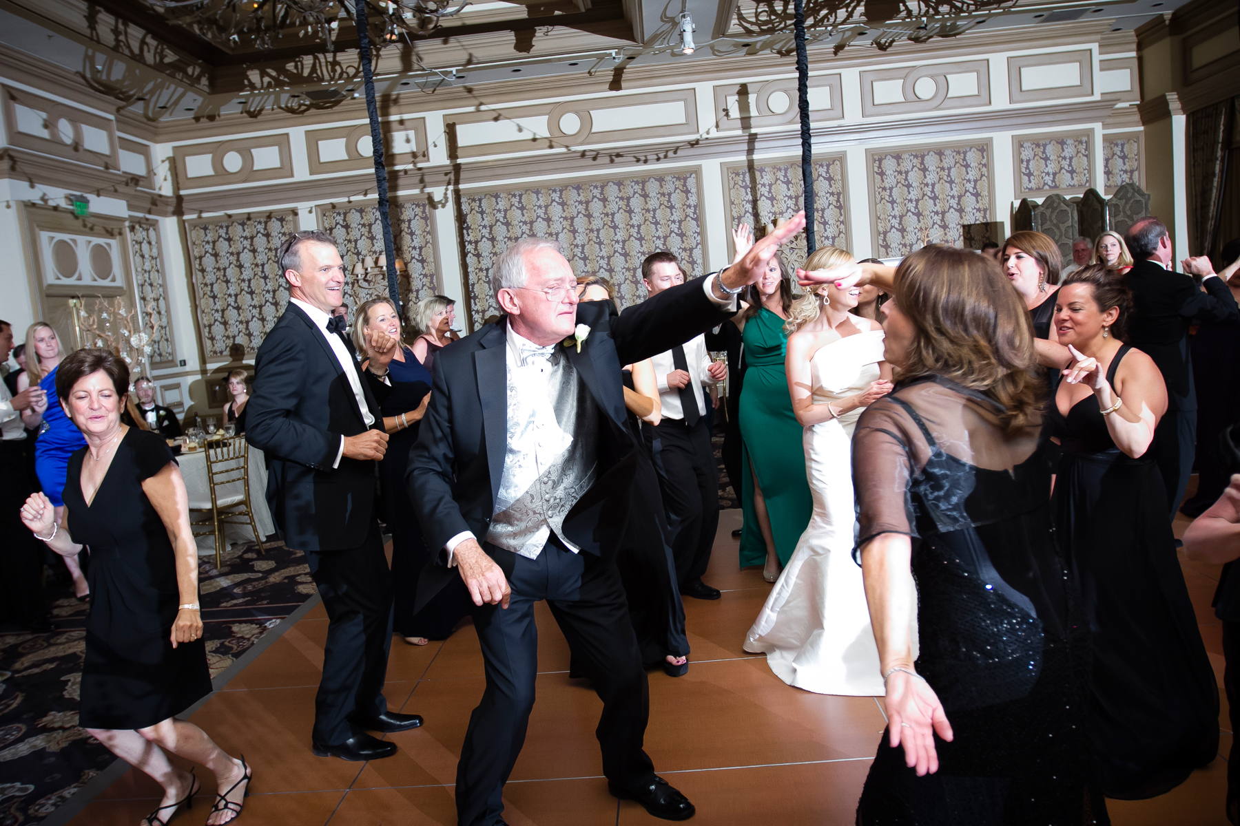 The father of the bride certainly knows how to party!  Wedding Venue:  Bellagio Las Vegas.   Photo by  www.ronmiller.com .  Las Vegas Wedding Planner:  Andrea Eppolito Events .