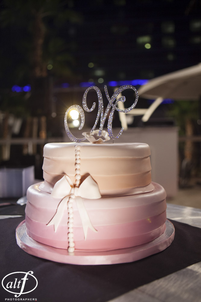 The pink and orange ombre wedding cake was gluten free and courtesy of Beaumonte Bakery in Las Vegas. Las Vegas Wedding Planner Andrea Eppolito Events. LocationL Hard Rock Hotel Las Vegas. Photography by www.altf.com.