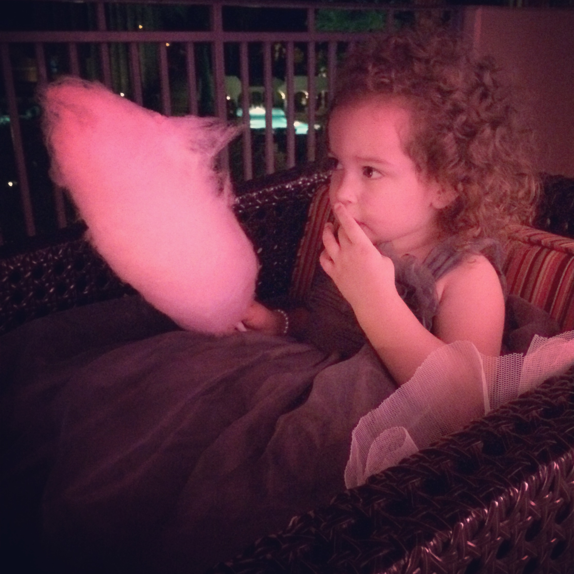 Flower Girl Sierra enjoyed hand-turned cotton candy on the patio.   Las Vegas Wedding Planner: Andrea Eppolito | Wedding Venue: Westin Lake Las Vegas | Floral and Decor: Naakiti Floral