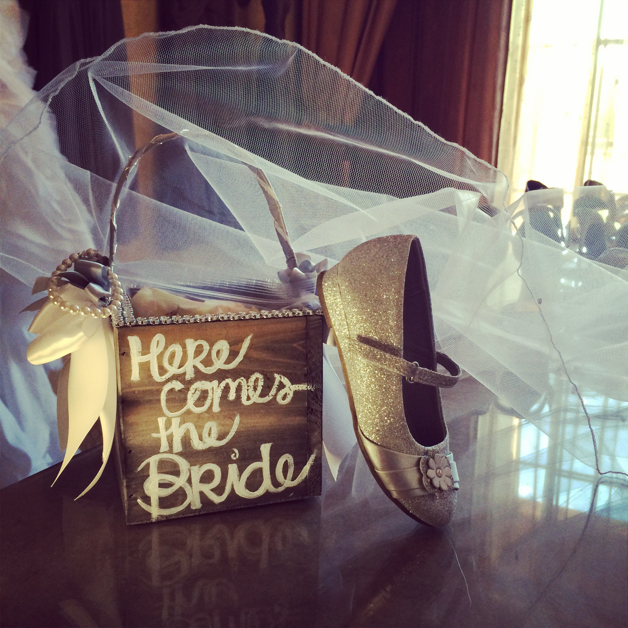 Flower Girl Accessories included a hand painted flower petal basket and sparkling shoes.