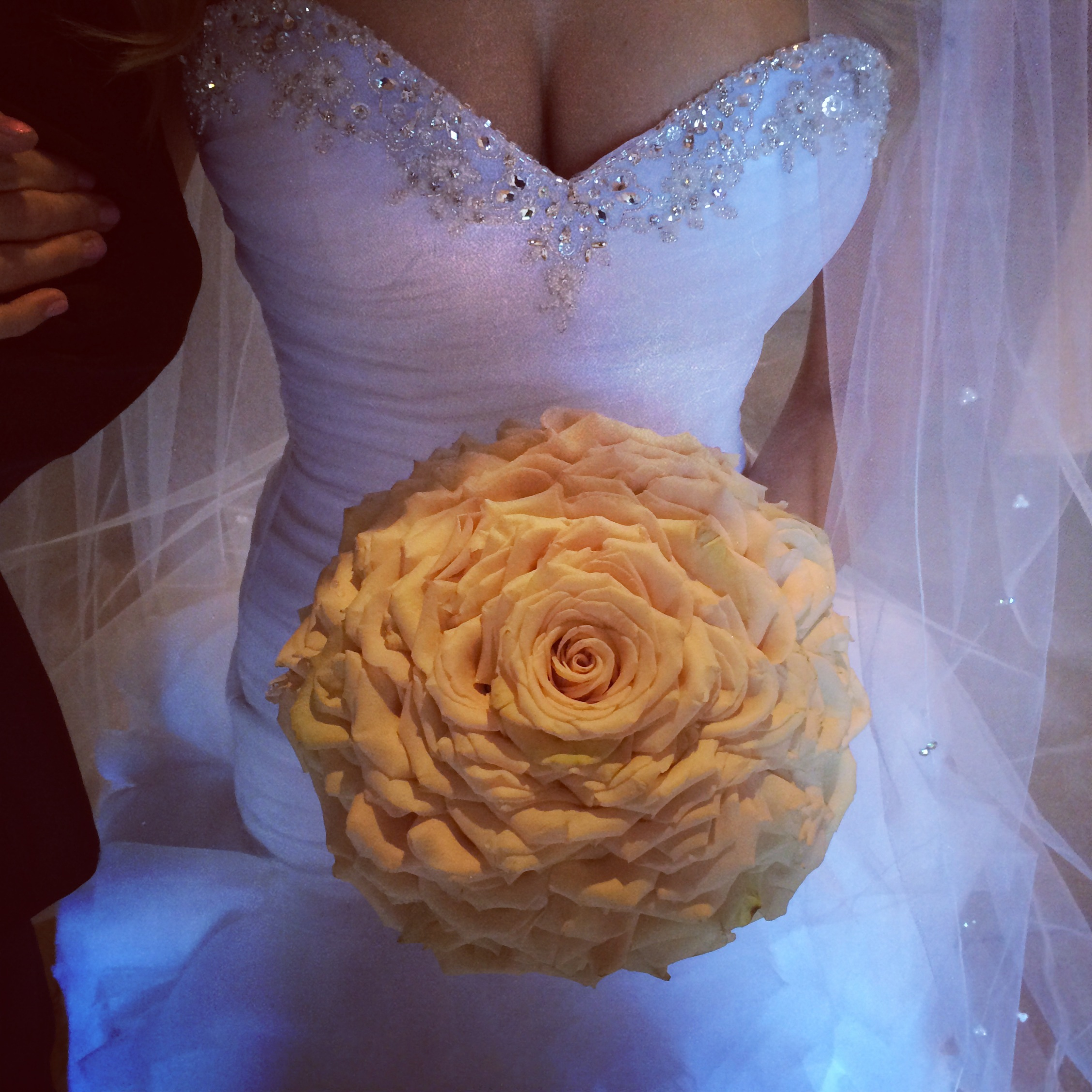 The Grand Rose takes hours to make, and requires over 3 dozen roses to be taken apart petal by petal and sewed back together by hand. Amy was so in love with this.    Las Vegas Wedding Planner: Andrea Eppolito | Wedding Venue: Westin Lake Las Vegas | Wedding Dress: Cosmobella | Floral and Decor: Naakiti Floral