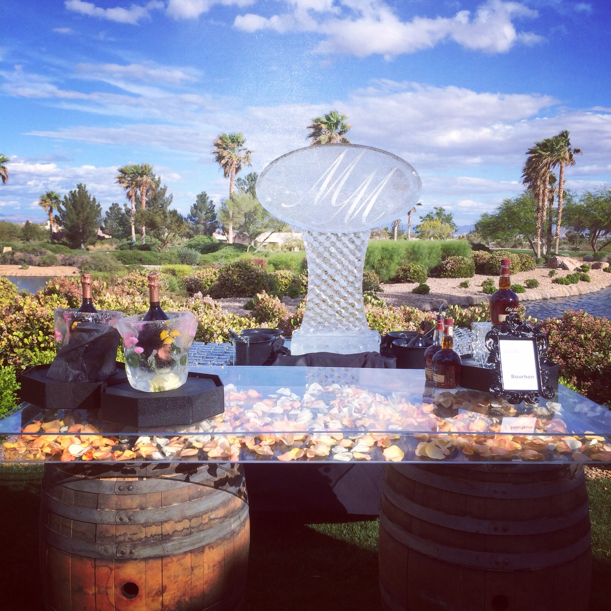 Ice, Ice Baby....Ice is making a comeback at weddings in the most beautiful way. Sculpture by  Plexi glass wine barrel display by  Sit On This .