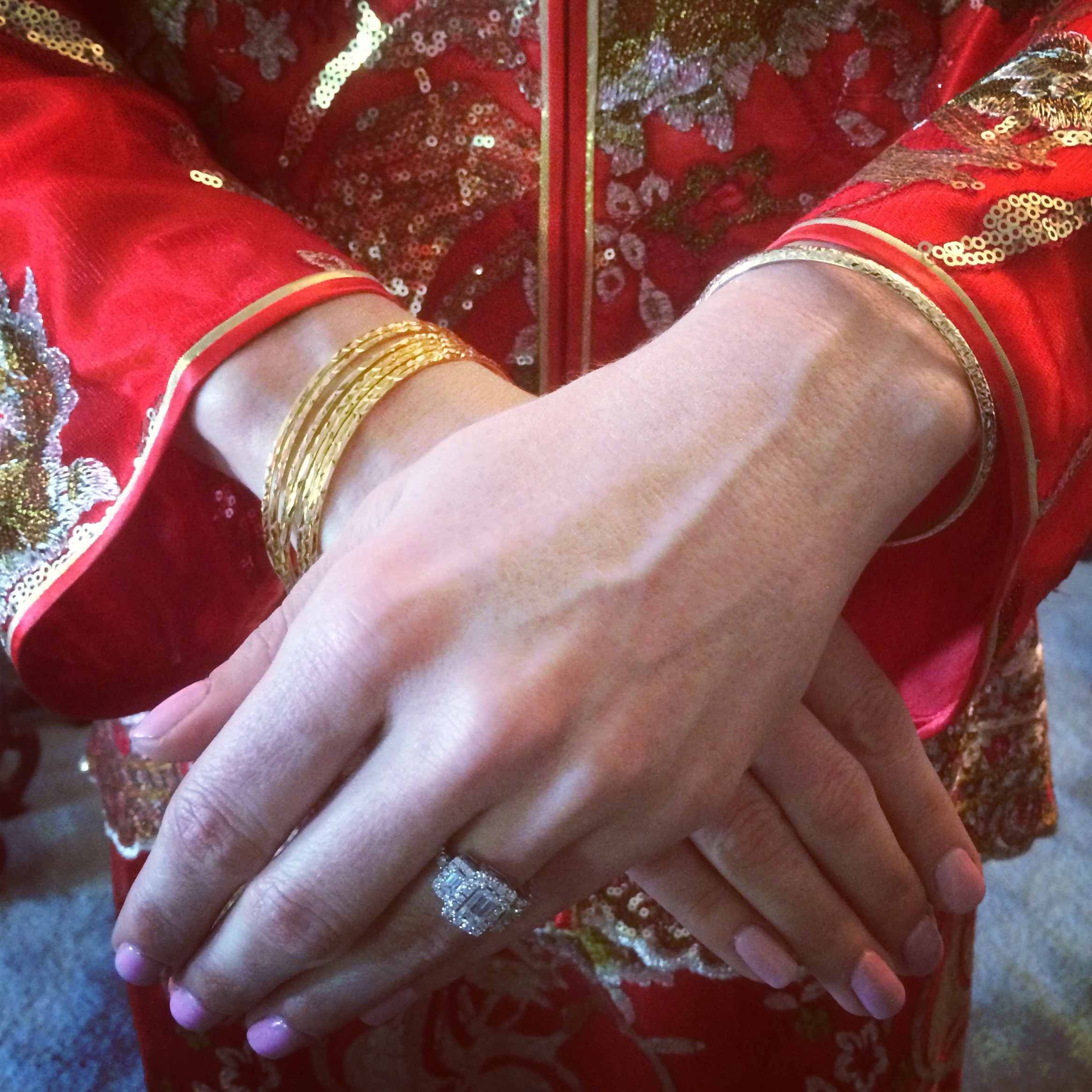 The bride was given beautiful gold bangle bracelets, along with earrings and a necklace, from her new in-laws during the Chinese Tea Ceremony.Photo by Andrea Eppolito.
