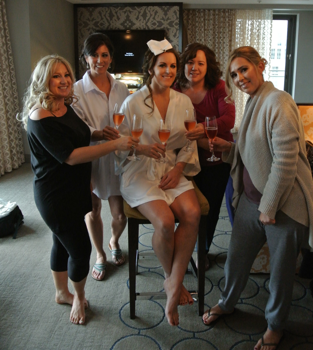 Michelle shared a champagne toast with her sister and her bridesmaids while getting ready in her suite at The Cosmopolitan. Photo by Andrea Eppolito.