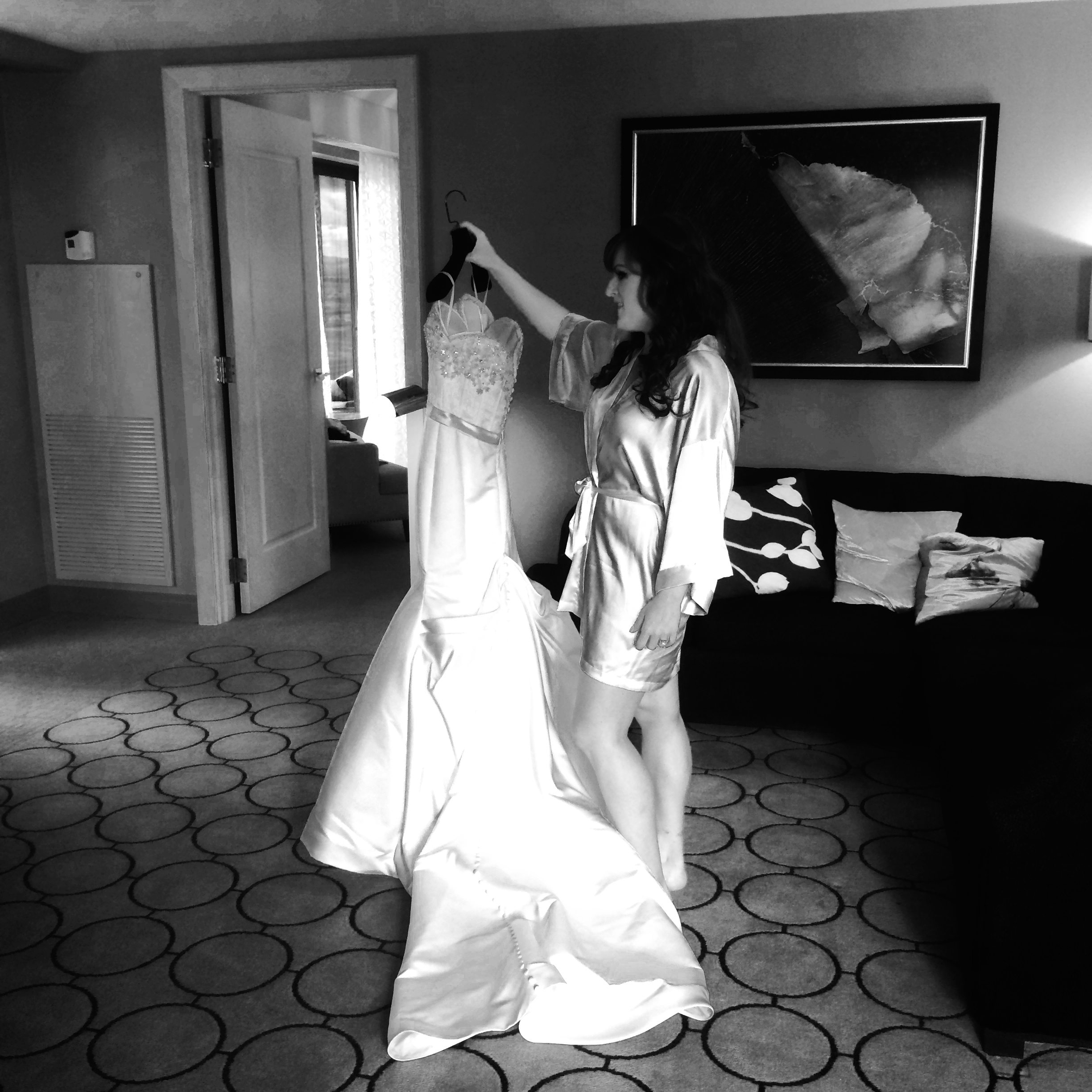 The bride took a moment with her dress. Photo by Andrea Eppolito.  Gown:  Victor Harper |Salon:  Couture Bride Las Vegas .