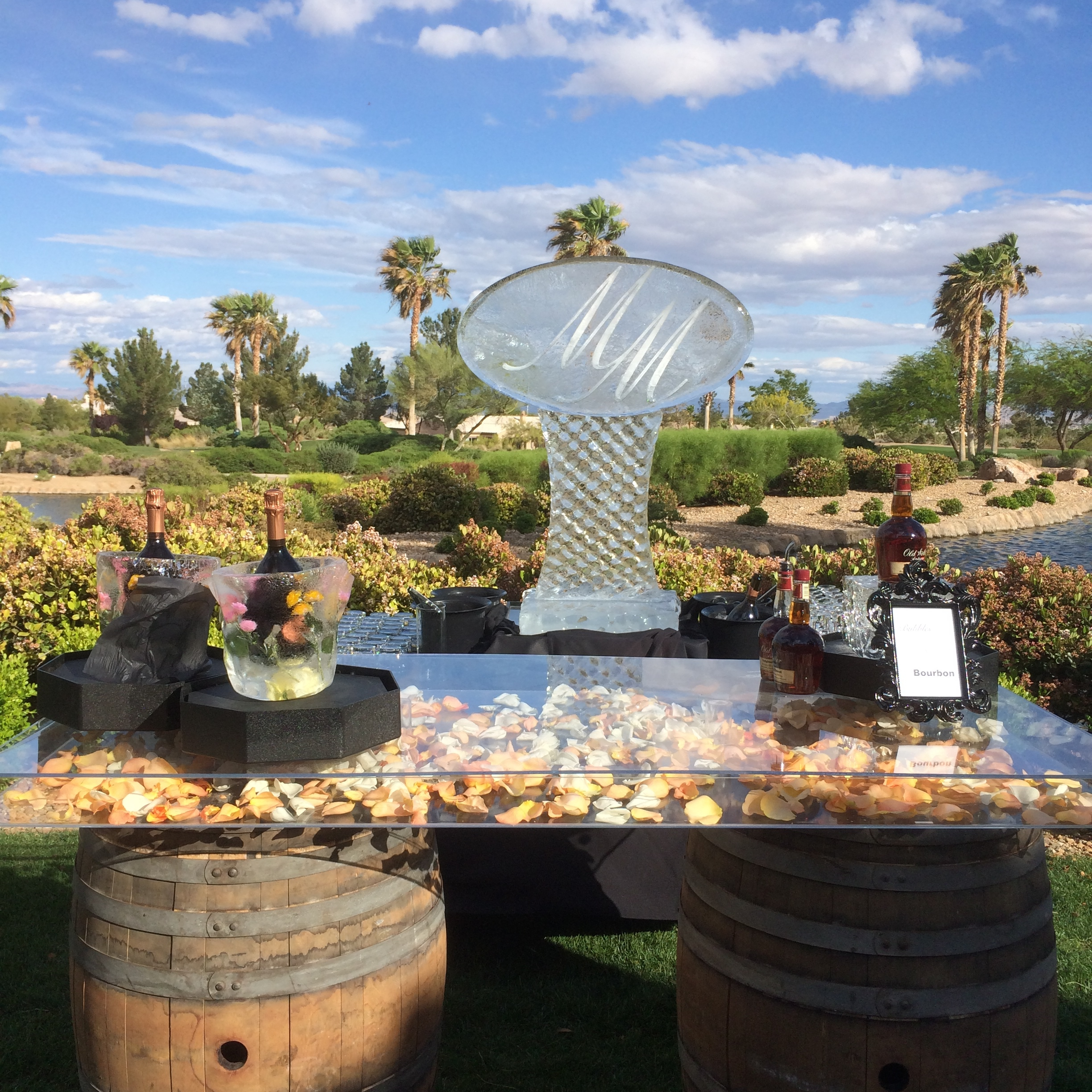 The Bubbles and Bourbon Bar.Photo by Andrea Eppolito.  Las Vegas Wedding Planner  Andrea Eppolito  | Barrels & Table:  Sit On This  | Sculptures:  Ice Occassions of Las Vegas .