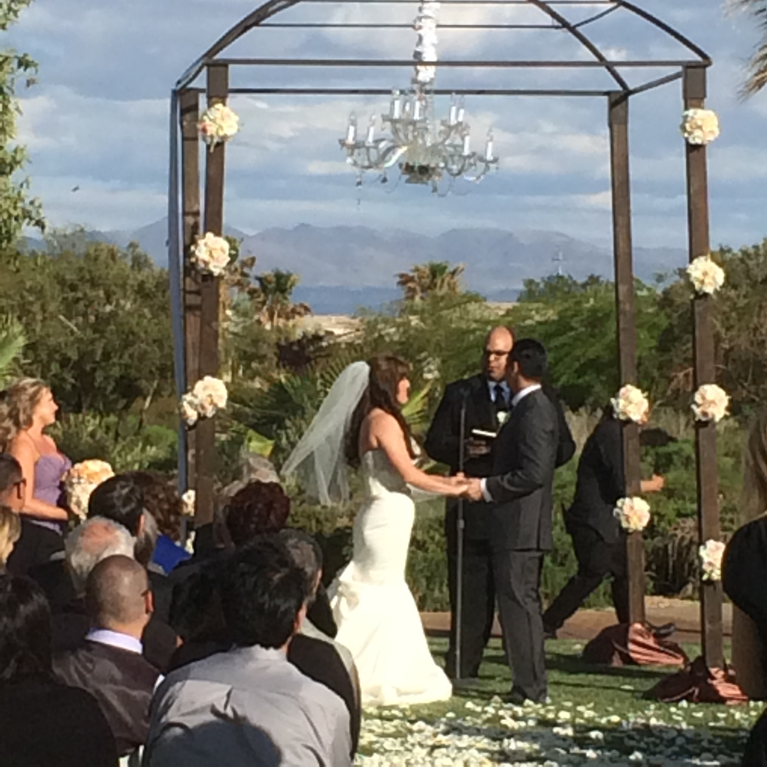 A bit blurry, but beautiful! We were all set for rain and tracked the weather all day! Moments before the ceremony, the sun came out and it was perfect!Photo by Andrea Eppolito.  Las Vegas Wedding Planner Andrea Eppolito | Floral & Decor: Naakiti Floral and Sit On This