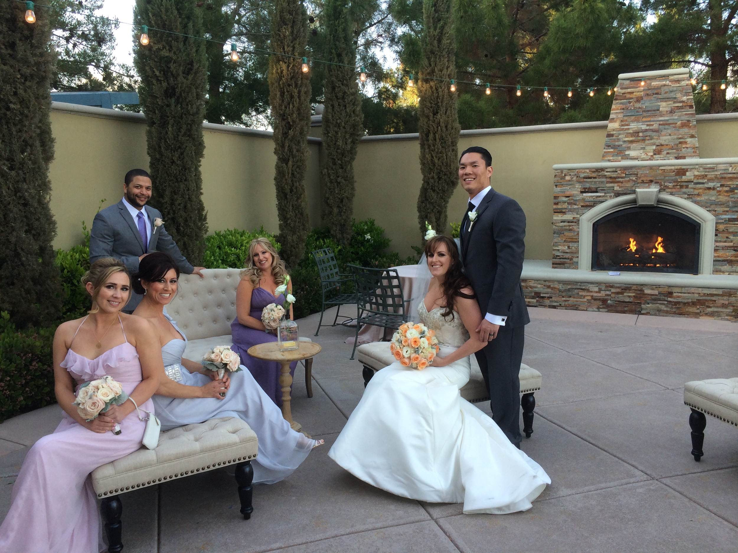 Setting the stage for a contemporary bridal party picture. The courtyard featured a fireplace and bistro lighting, and was used for the cocktail reception.Photo by Andrea Eppolito.  Las Vegas Wedding Planner Andrea Eppolito | Las Vegas Venue: |Floral & Decor: Naakiti Floral and Sit On This