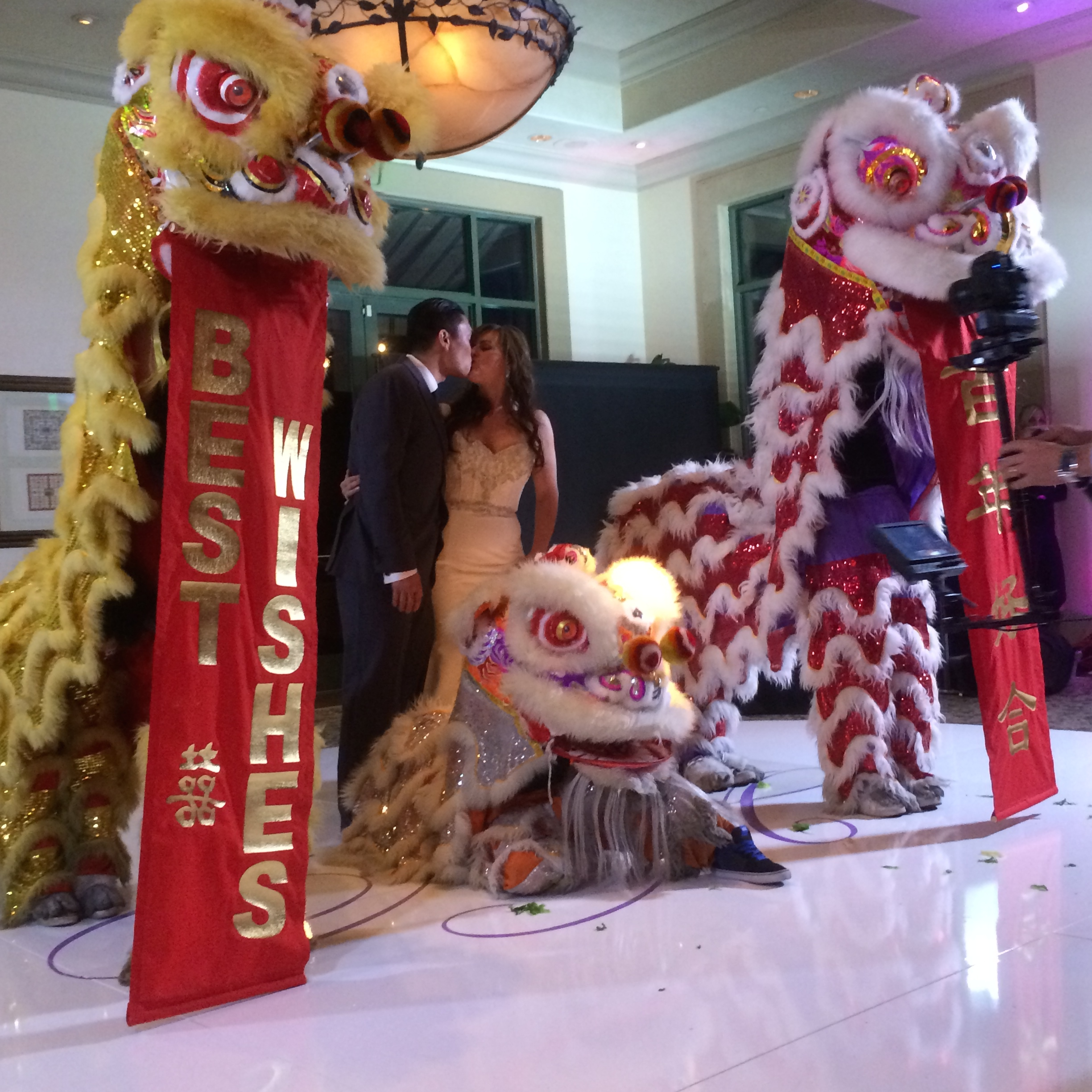 Celebrating with the lions of the Las Vegas Kung Fu Academy. Photo by Andrea Eppolito.  Las Vegas Wedding Planner Andrea Eppolito | Las Vegas Venue: Siena Golf Course |Floral & Decor: Naakiti Floral and Sit On This