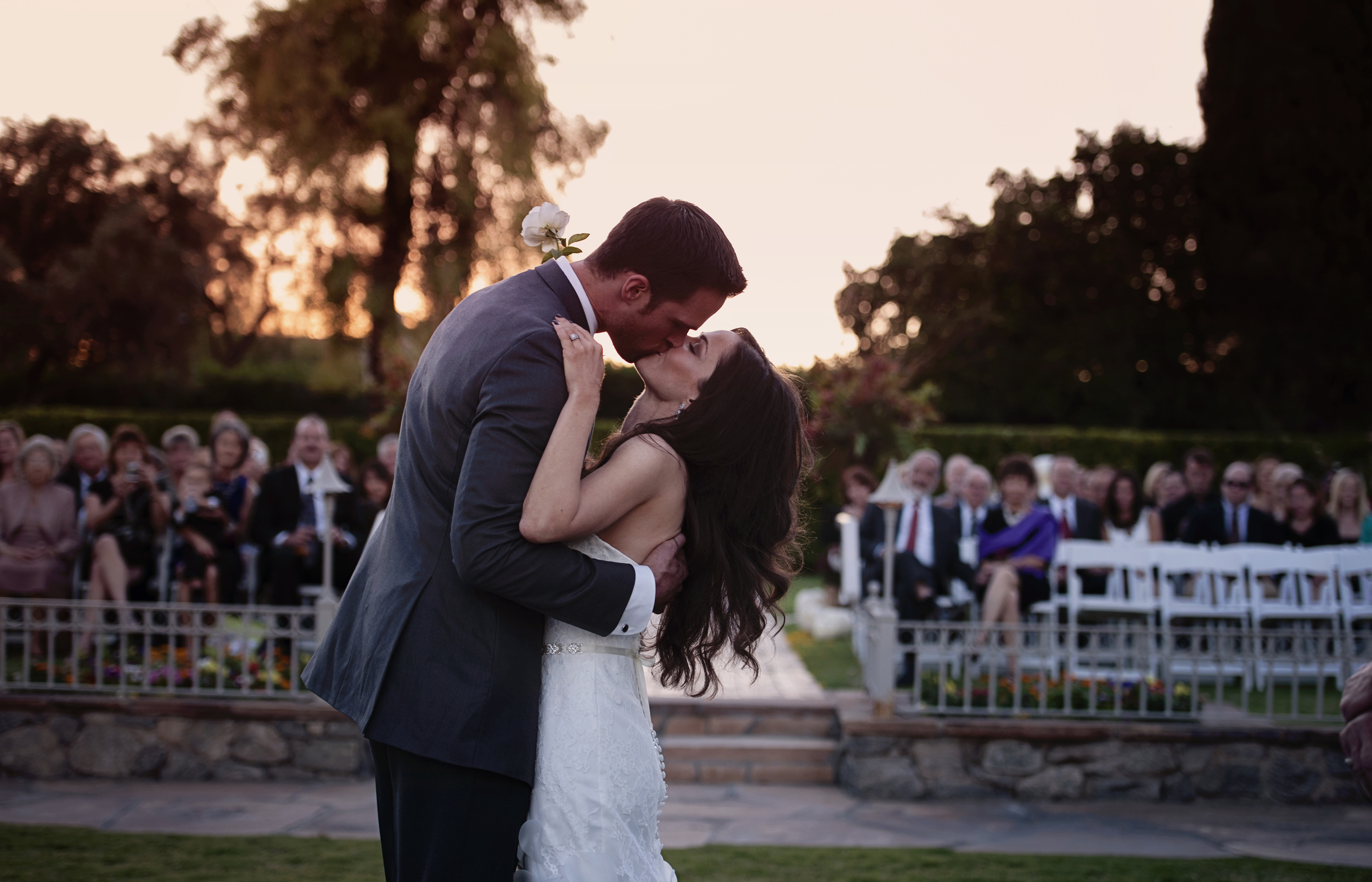 The First Kiss at the Arizona Inn in front of their friends and family.    Destination Wedding Planner:   Andrea Eppolito Events   |  Historical Wedding Venue:   The Arizona Inn   |  Photography:  Raylene Streuber