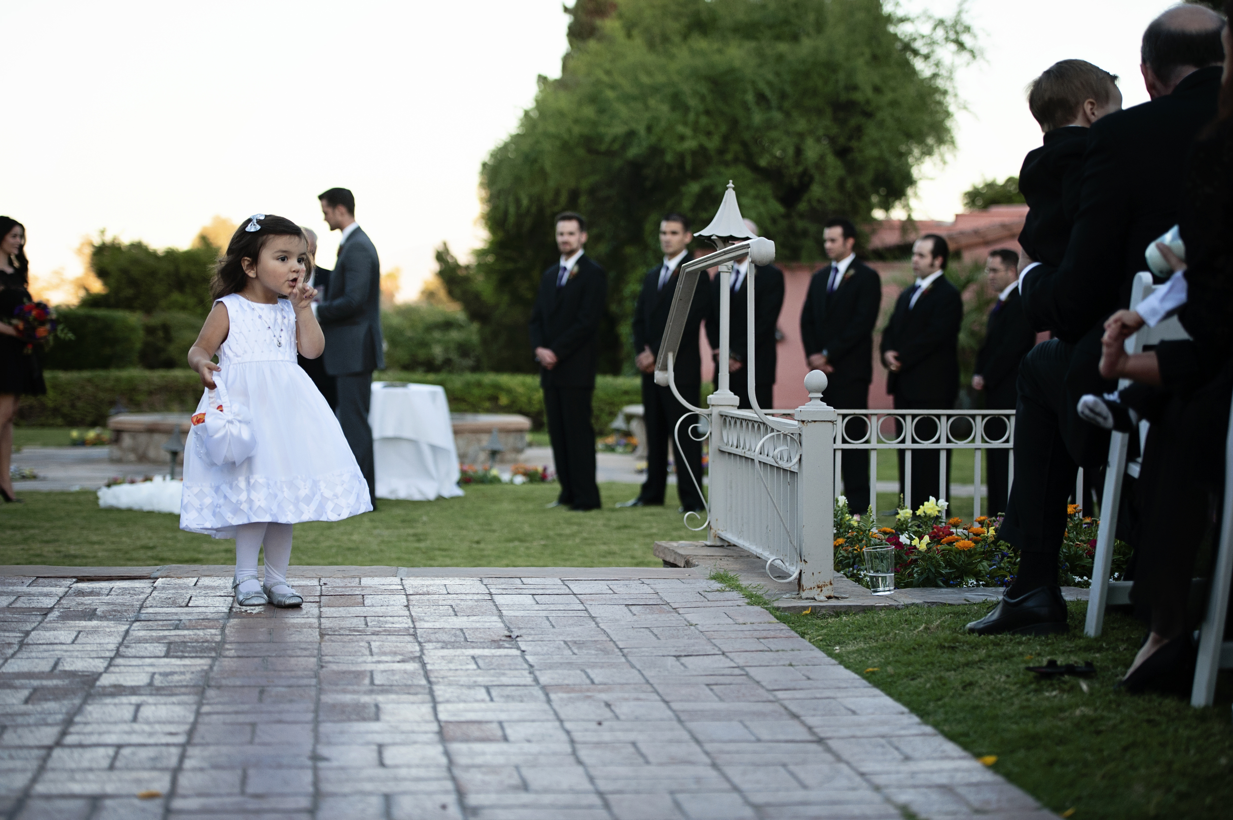 The flower girl took her job very seriously, and shushed guests who were chatting!    Destination Wedding Planner:   Andrea Eppolito Events   |  Historical Wedding Venue:   The Arizona Inn   |  Photography:  Raylene Streuber