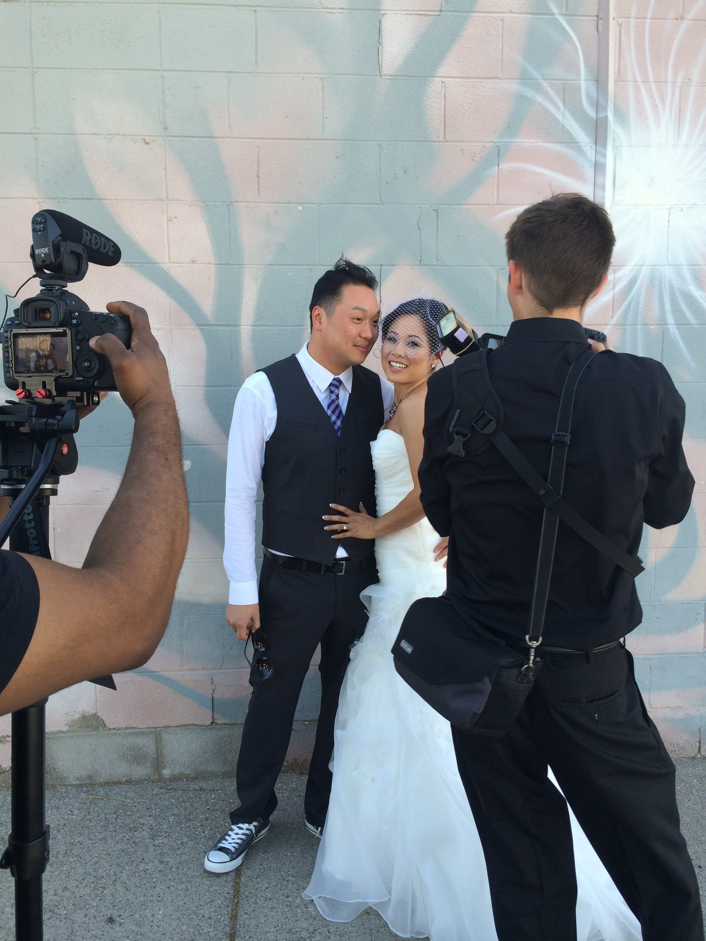 Behind the scenes at a wedding, it's all hands on deck and all work!  Las Vegas Wedding Photographer Adam Frazier, Las Vegas Wedding Videographer Lighten Films, and Photo by Las Vegas Wedding Planner Andrea Eppolito.