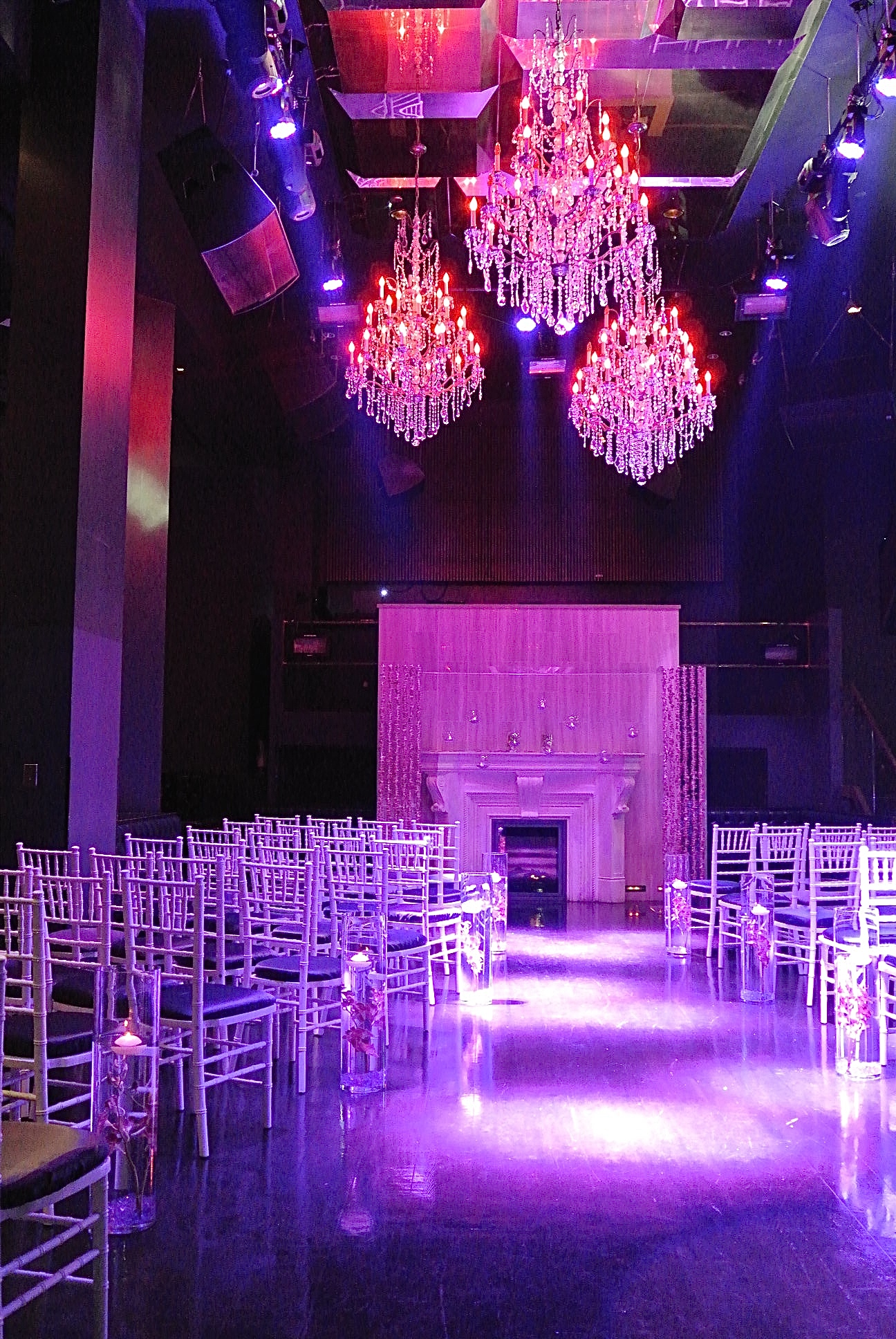 Shades of purple, pink, and red were brightened with white light for the wedding at Chateau Nightclub.Photo by Las Vegas Wedding Planner Andrea Eppolito.