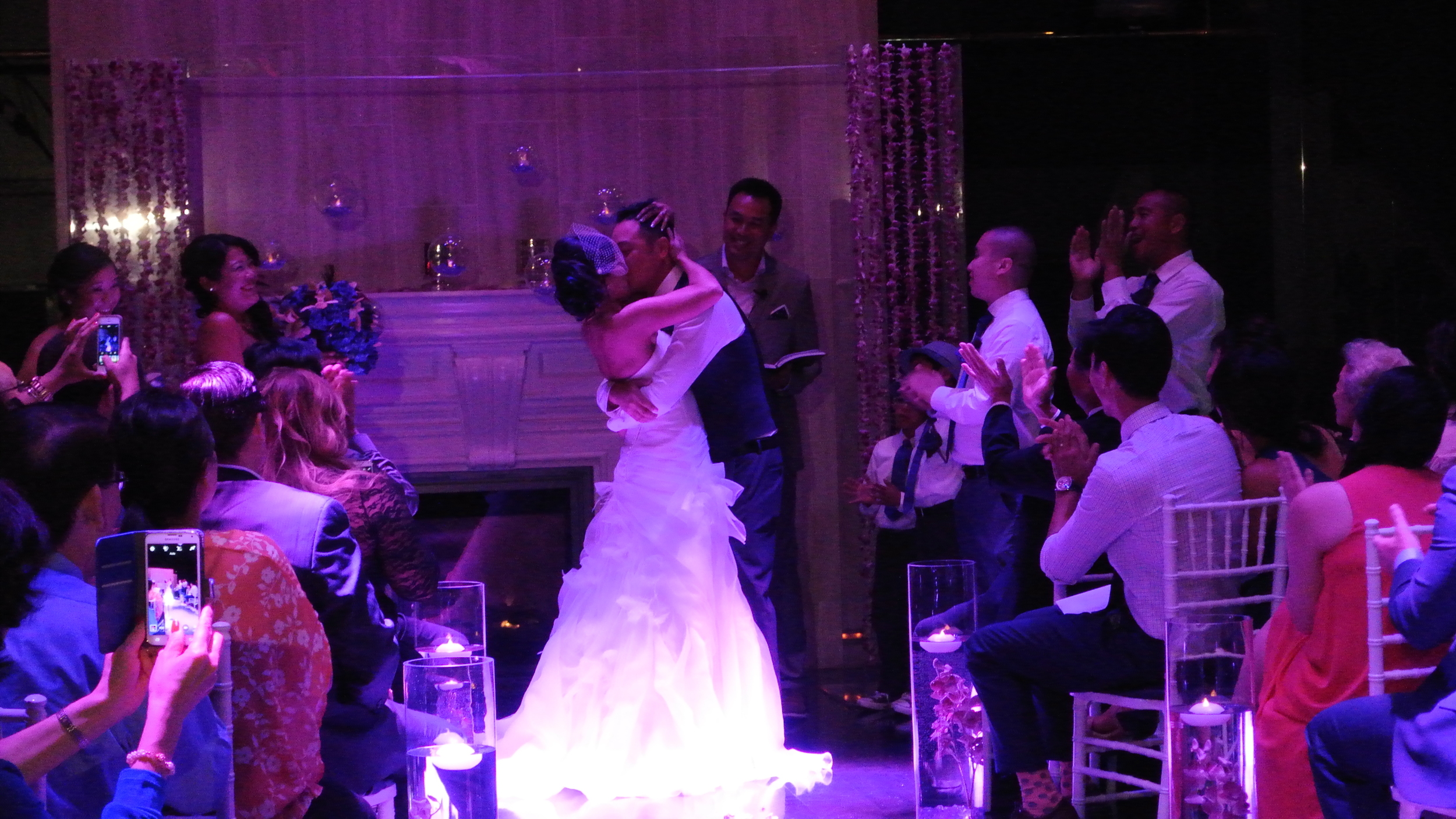 The first kiss!  Check out the guest taking a photo in the bottom left!  We made an announcement asking that they please be discrete so that the professionals could get the best shots, and after seeing a sneak peek of the photographer's pics, I know it was worth it!  Photo by Las Vegas Wedding Planner Andrea Eppolito.