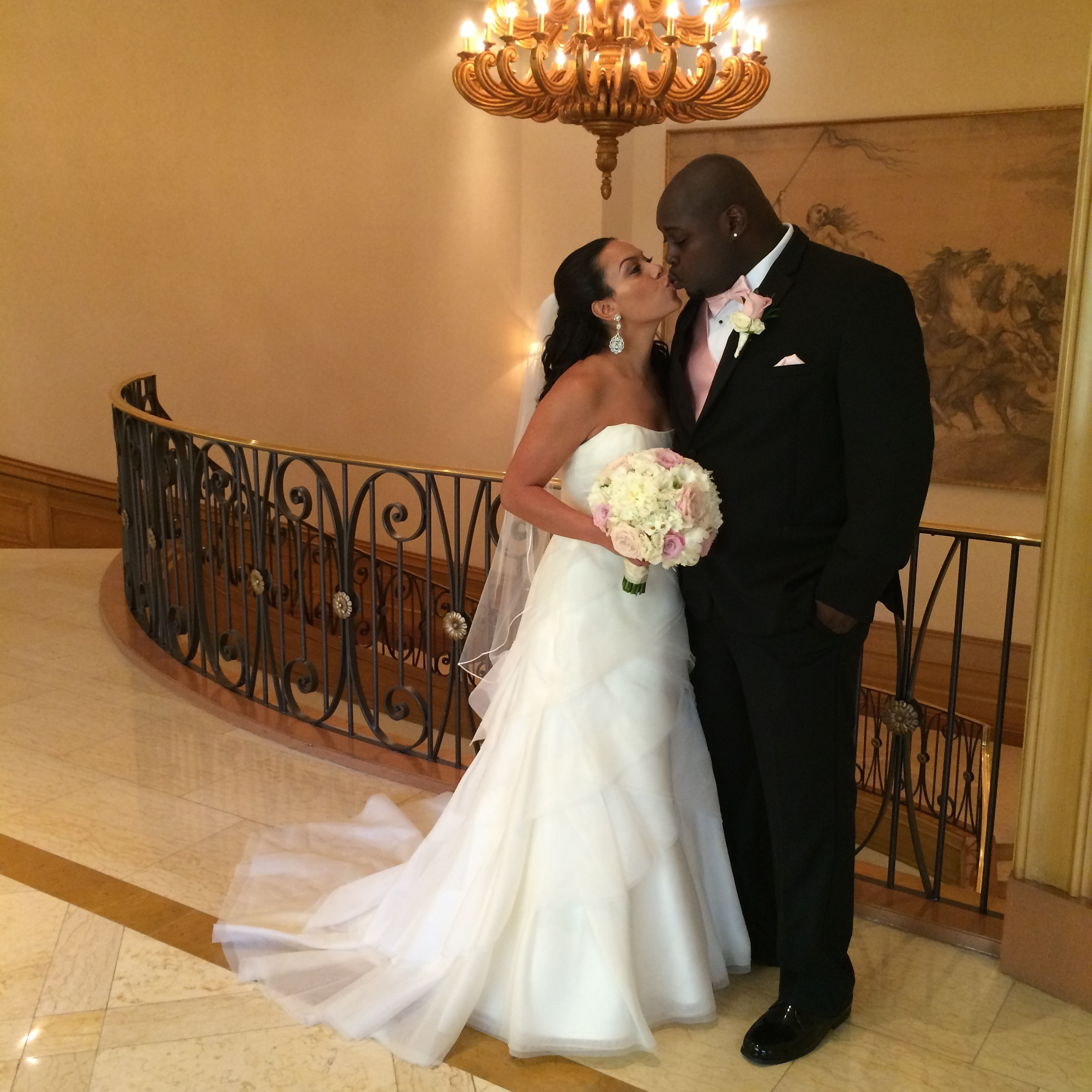 """Retired NFL Player Robert """"Rocky Bernard and Halona Grimes celebrated their wedding at the Four Seasons Las Vegas."""
